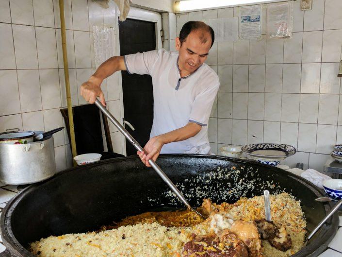 Uzbek man making plov