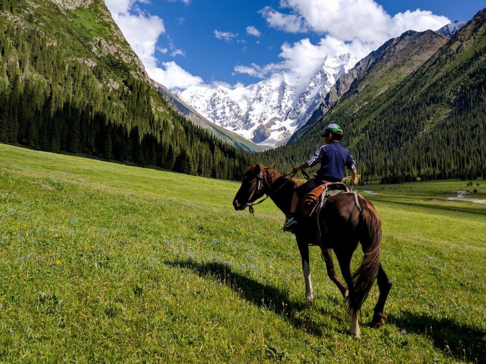 Young Kyrgyz boy a horse in Jety Oguz