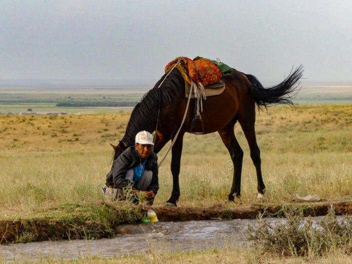 Man filling bottles with water in Kazakhstan