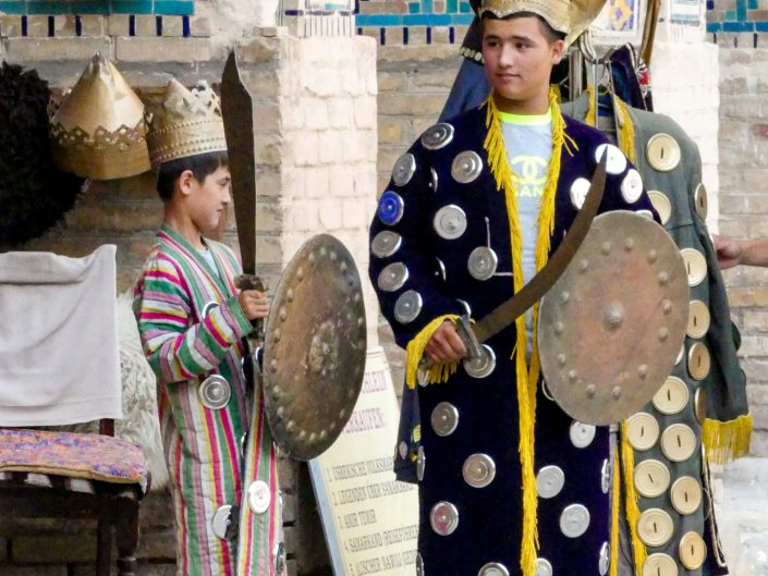 Two Uzbek boys wearing a traditional outfit in Samarkand