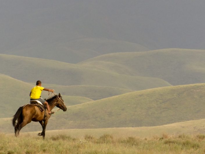 Kazakh boy riding a horse
