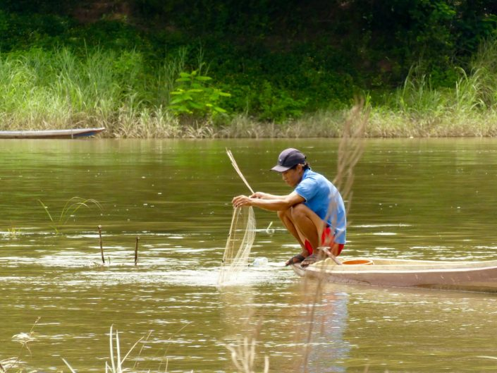 Man fishing in the Mekong River