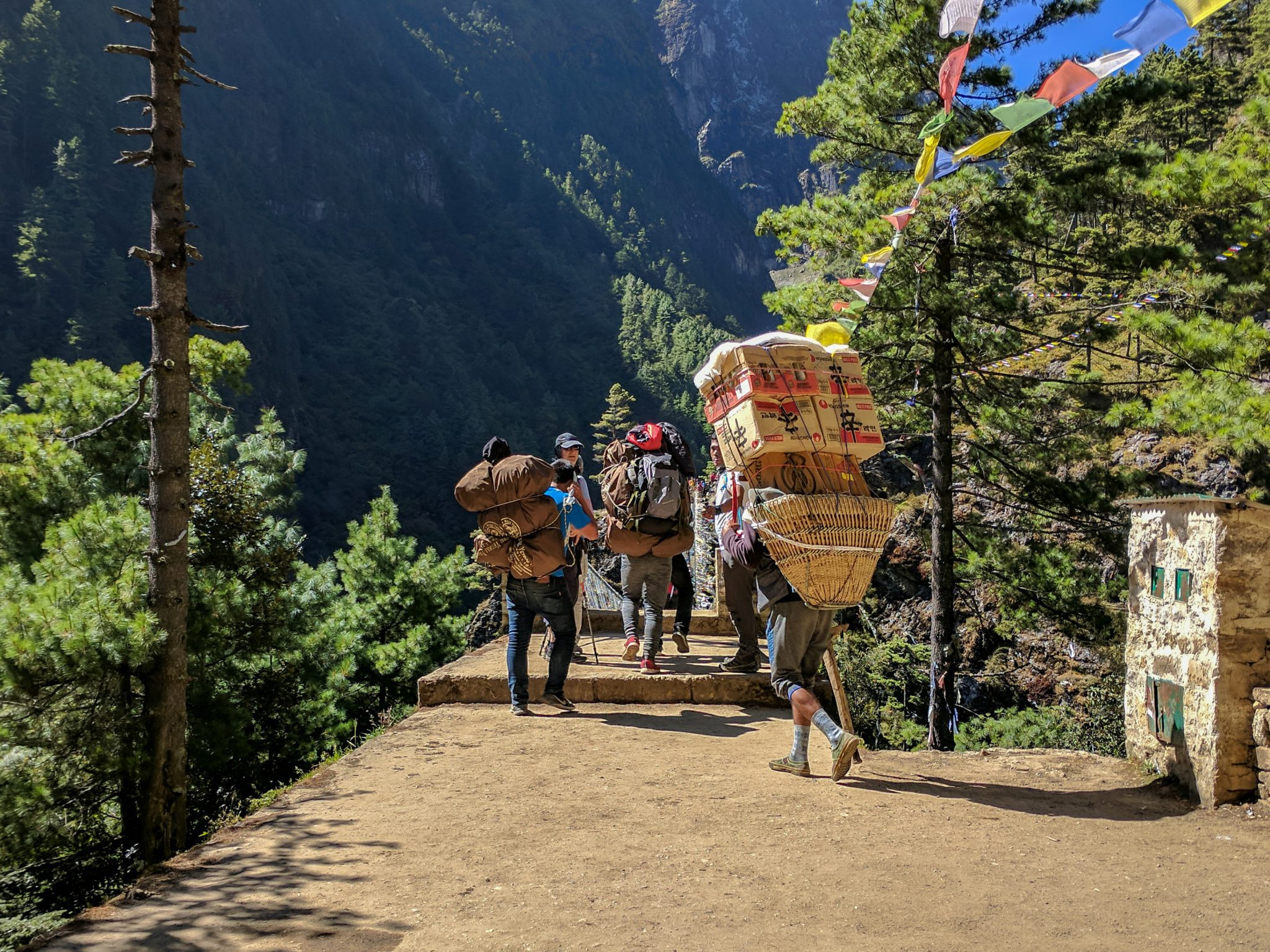Porters crossing a bridge